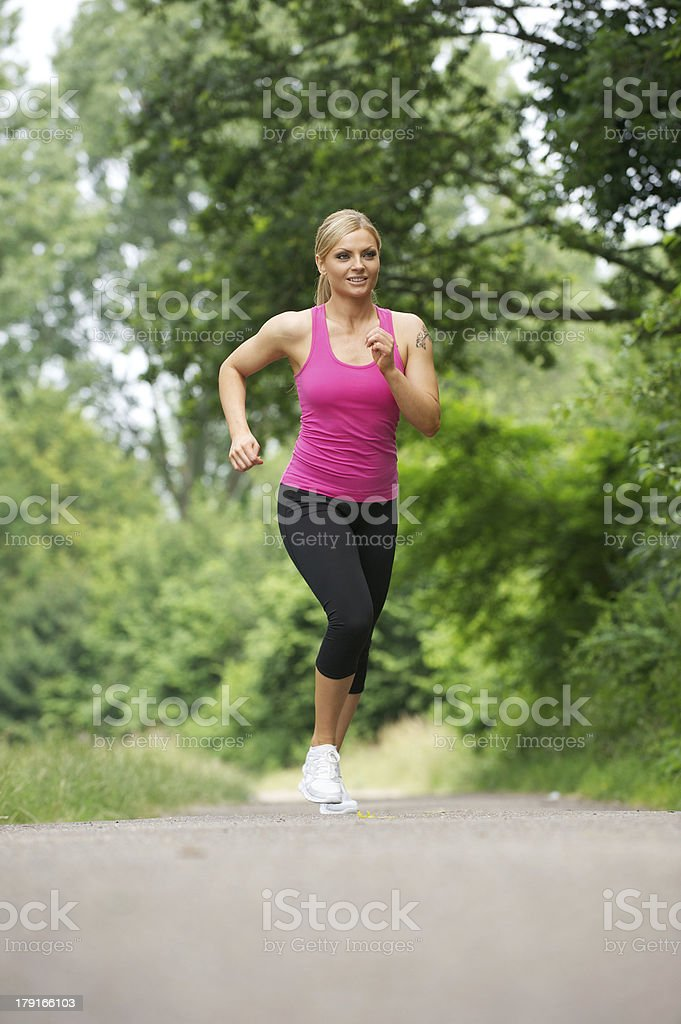 Fit young woman running in the park royalty-free stock photo