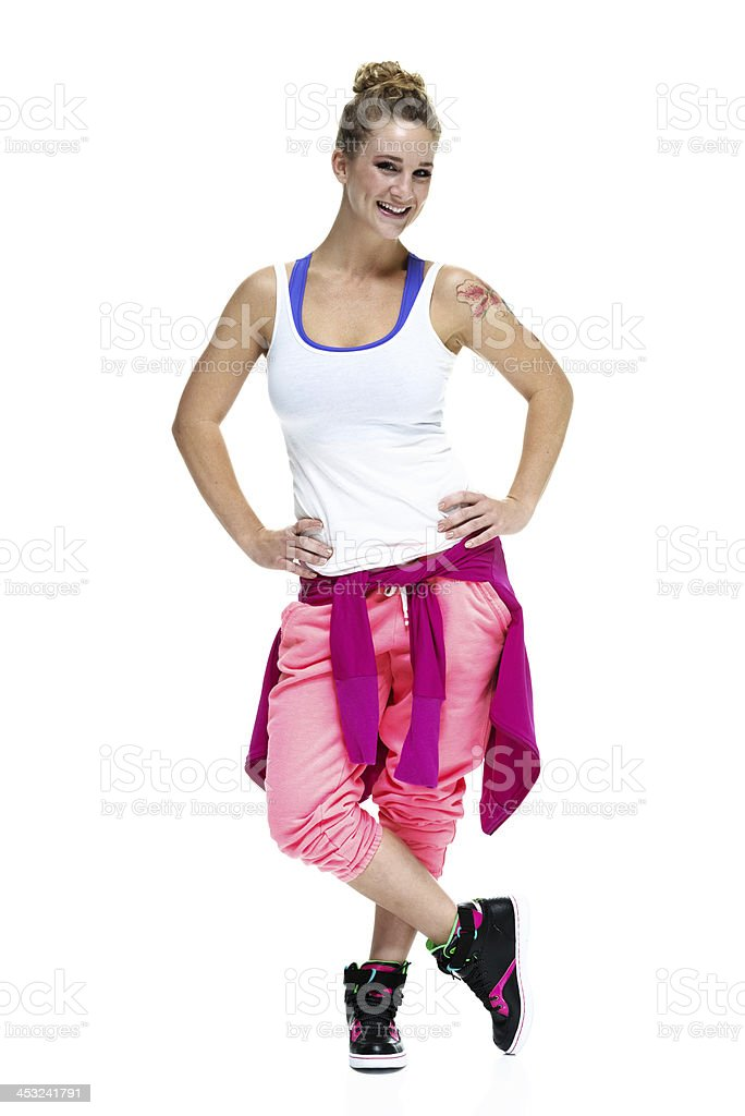 Fit young woman with a cheerful look stock photo