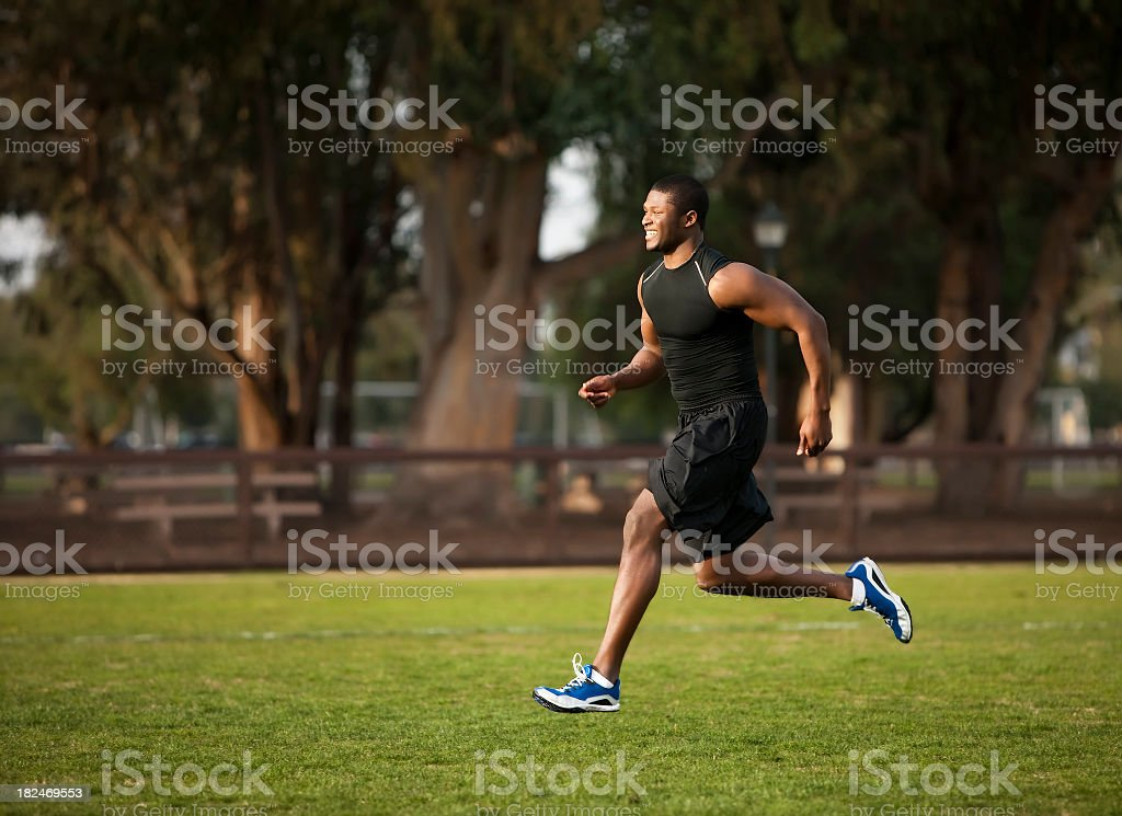 Fitness: African American Athlete Running royalty-free stock photo