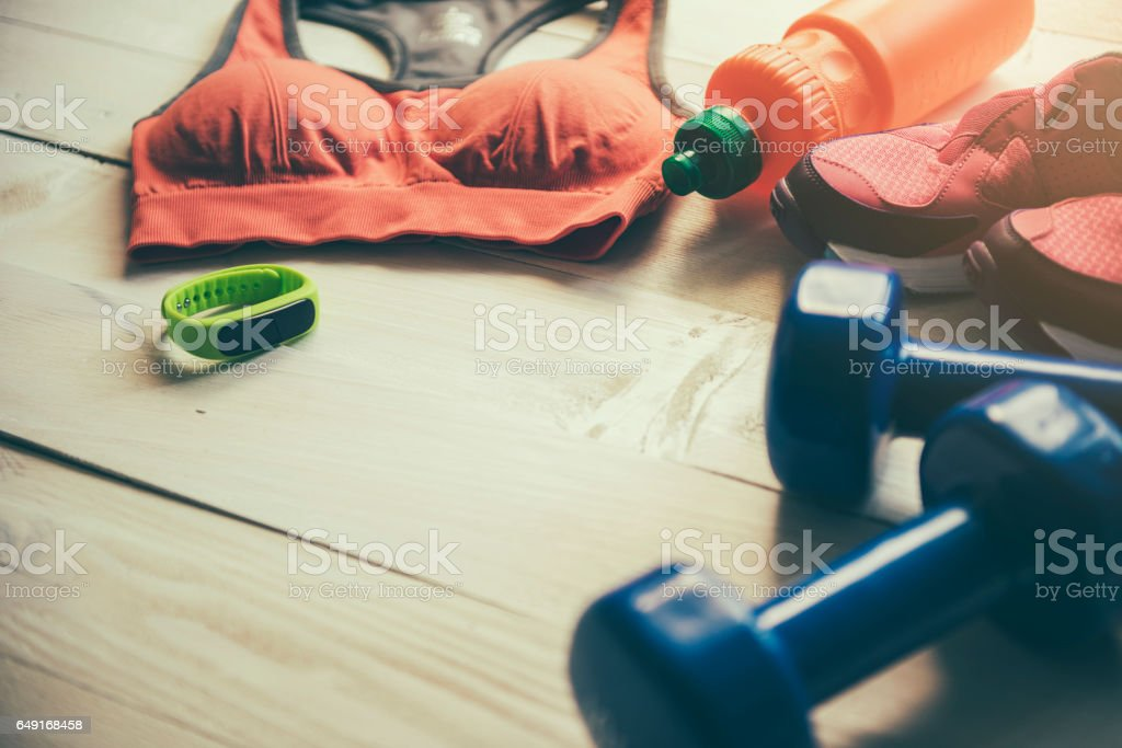 Fitness and sport equipment wooden background on top view stock photo