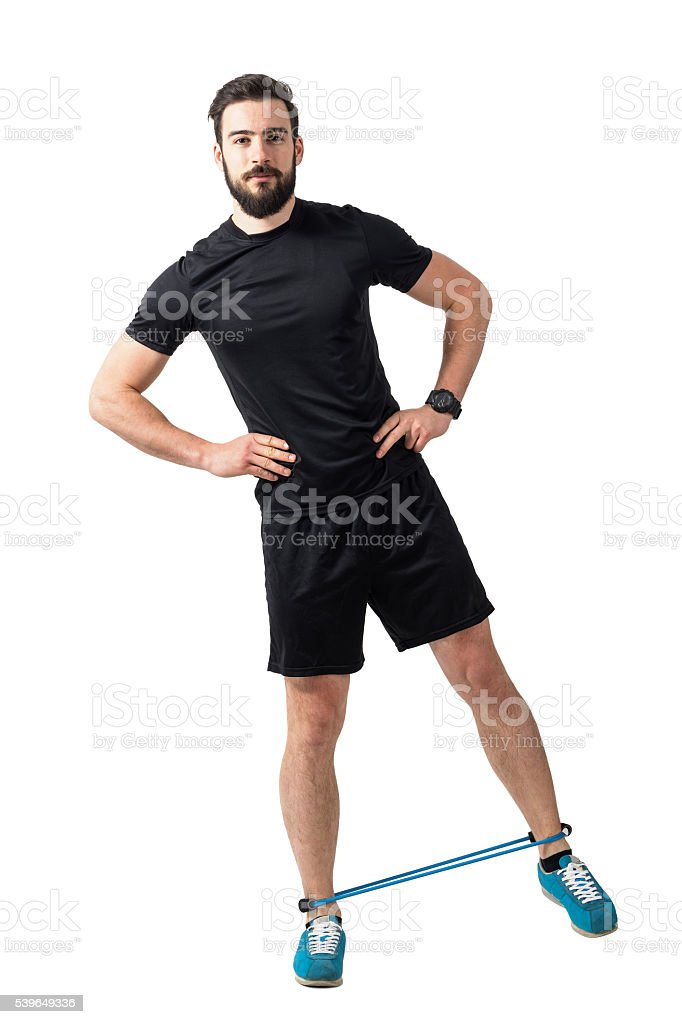 Fitness athlete doing side leg-lifts exercise with resistance bands stock photo