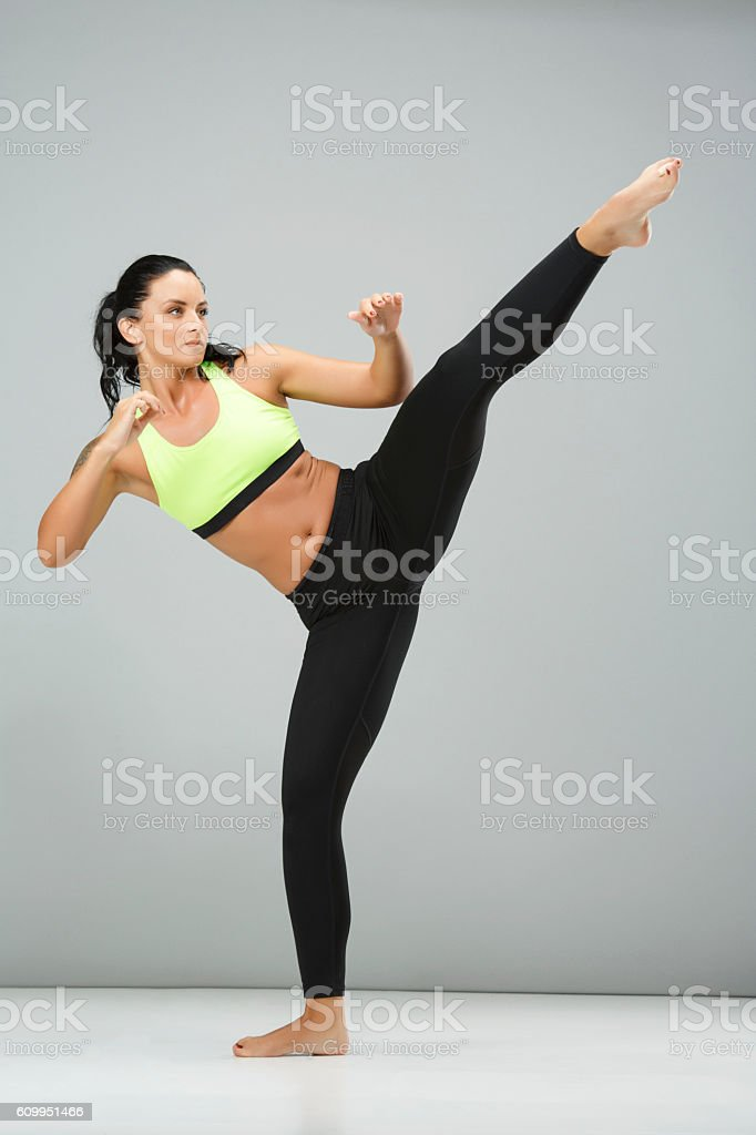 Fitness  Athletic young woman warms up before training   Female kickboxing stock photo
