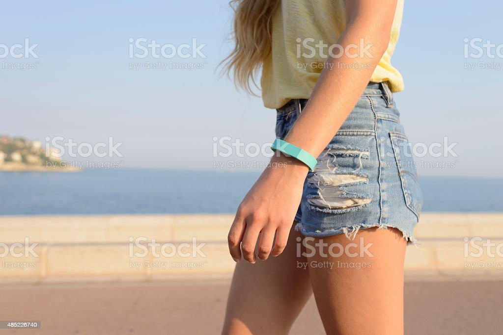 Fitness Aware Young Slim Female Walking by the Ocean stock photo