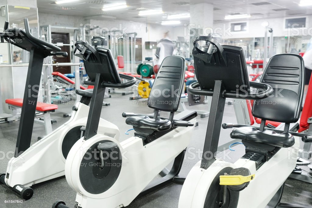 Fitness bikes in a fitness hall stock photo