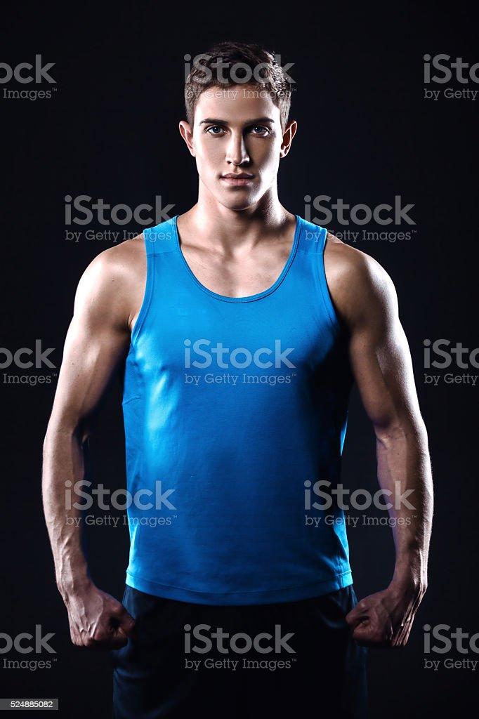 Fitness boy on black background stock photo