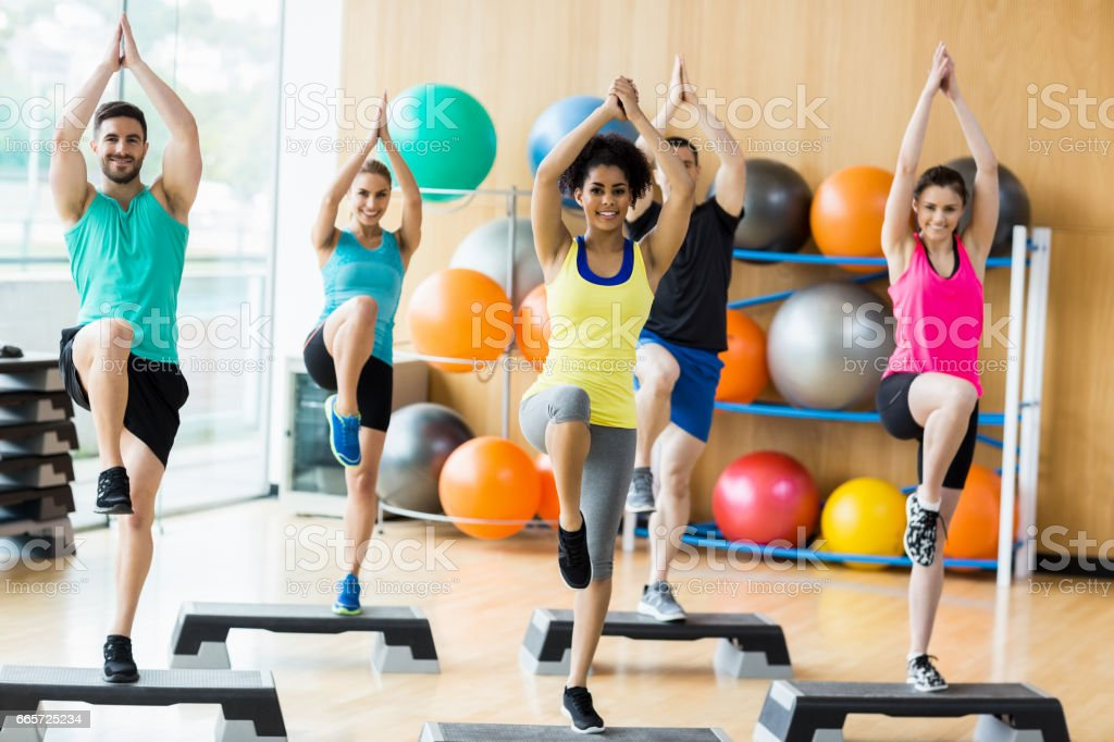 Fitness class exercising in the studio stock photo