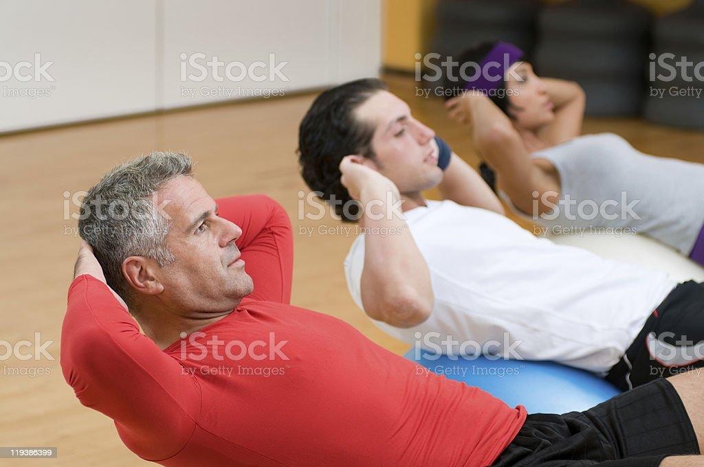 Fitness class making sit-ups stock photo