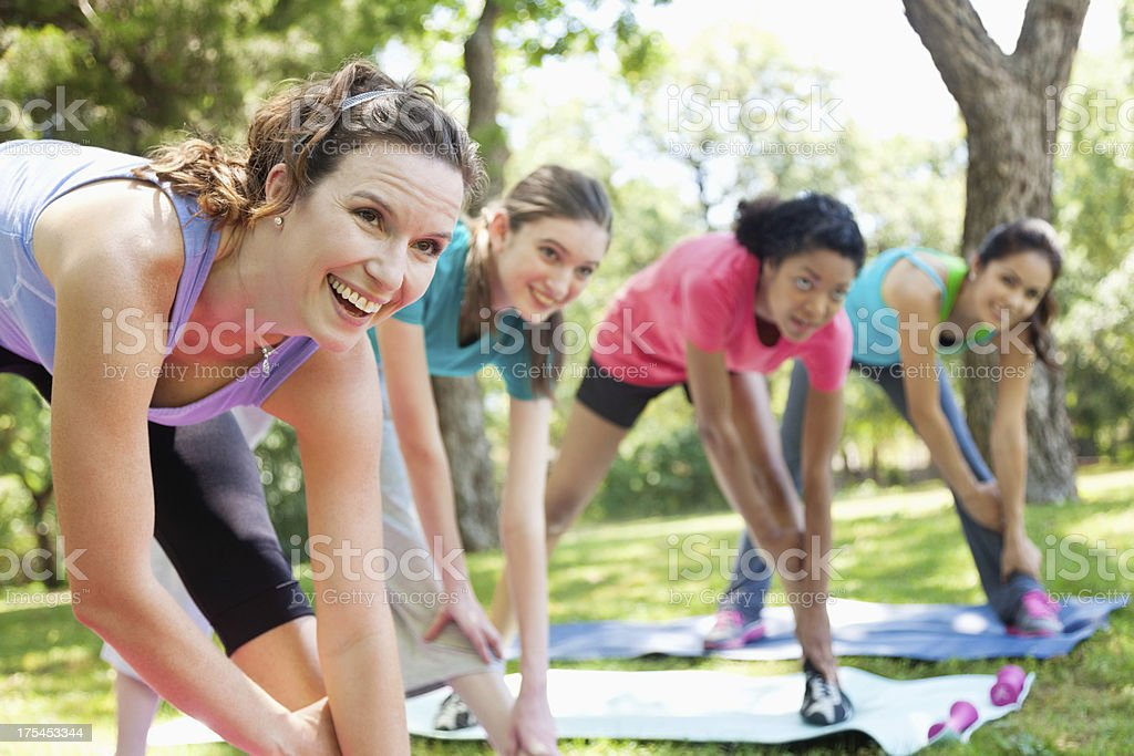 Fitness class of women doing stretch exercises royalty-free stock photo