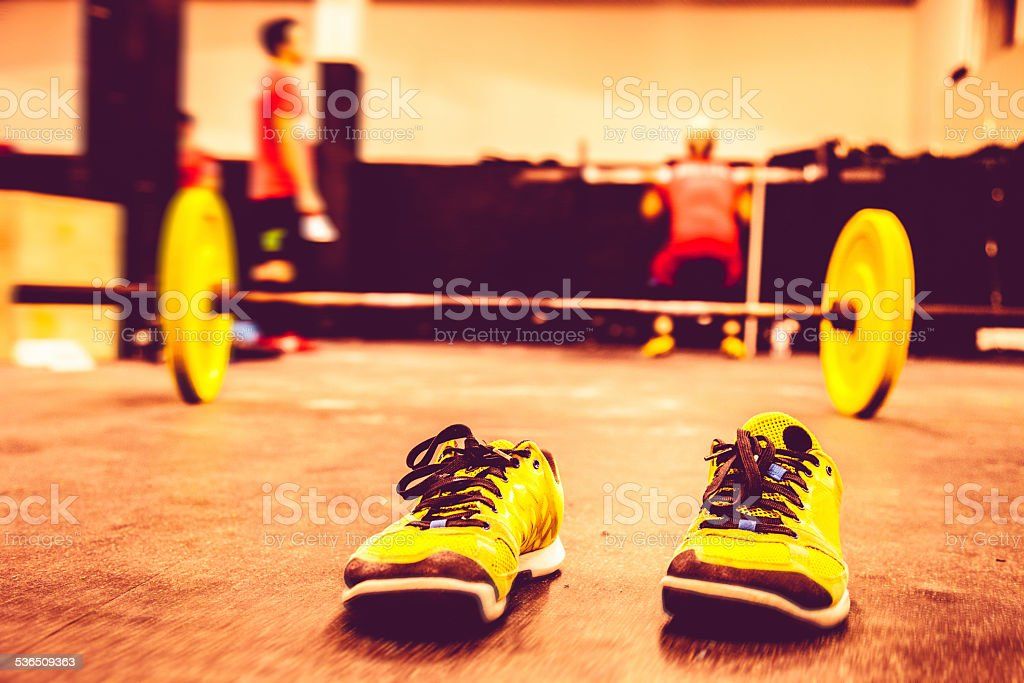 Fitness club, people exercising at the gym stock photo