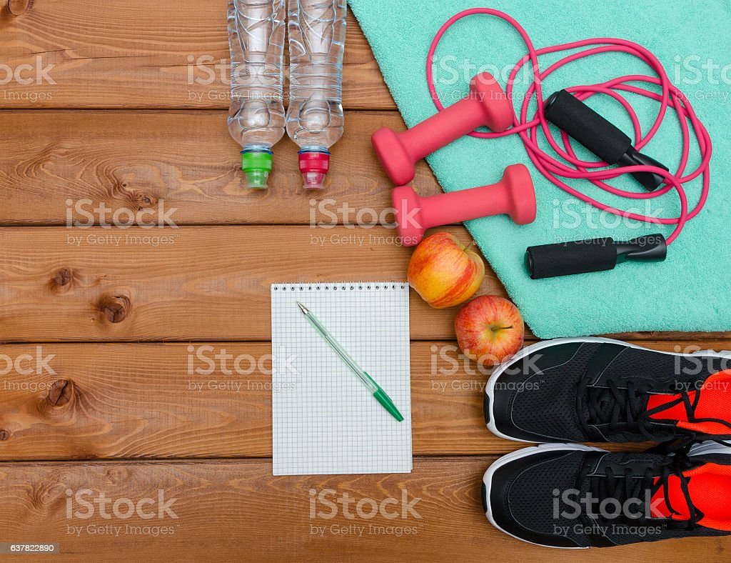 Fitness concept with sneakers dumbbells  towel bottle of water stock photo