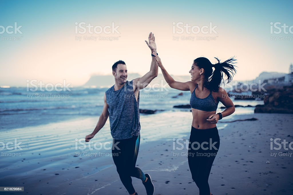 Fitness Couple giving each other high five after hard training stock photo