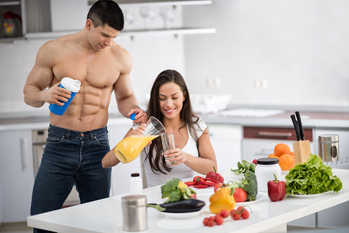 Image result for fitness couple in kitchen