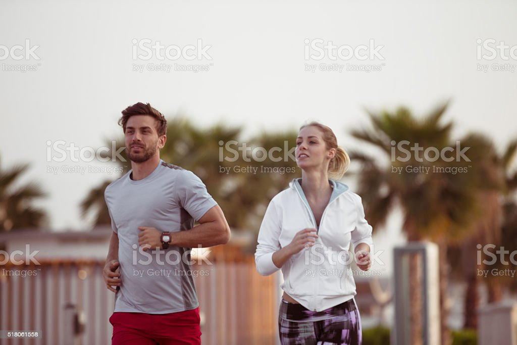 Fitness Couple Jogging Together stock photo