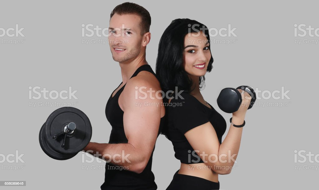 Fitness couple . Sporty couple posing on a background stock photo