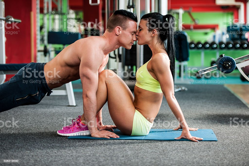 Fitness couple workout fit man and woman train in gym stock photo