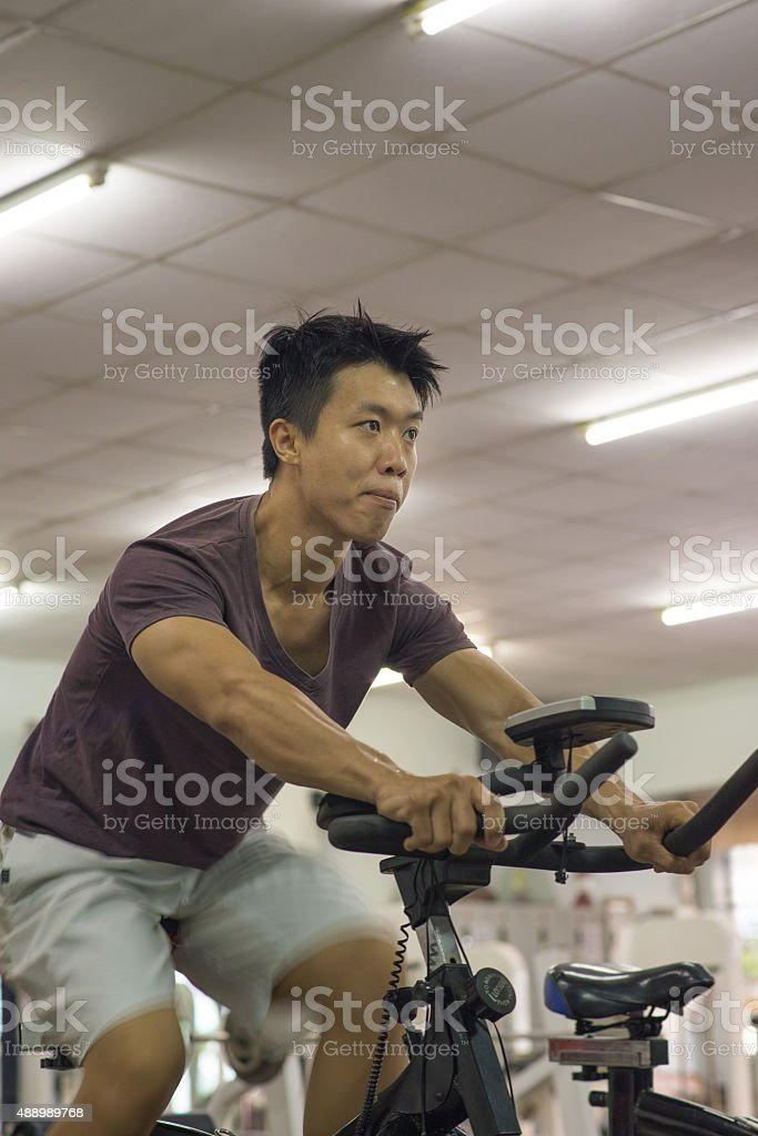 Young fitness man has a determined look on his face.