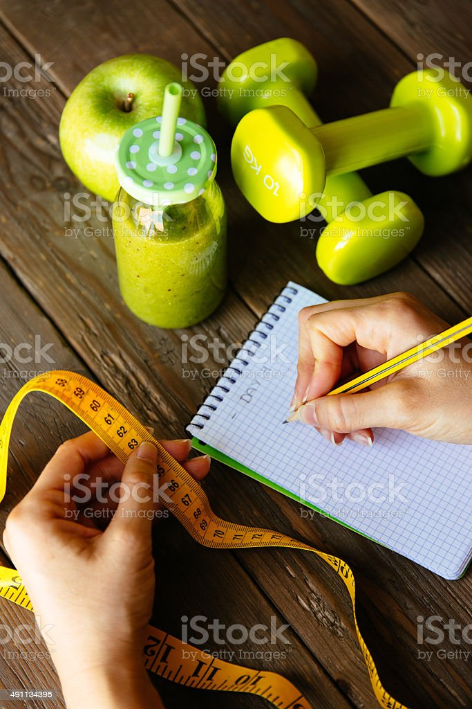 Fitness diet and nutrition routine concept with green detox smoo stock photo