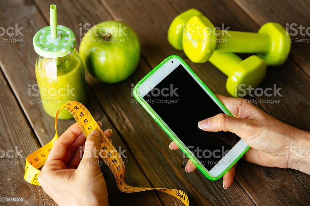 Fitness diet and nutrition smartphone app concept stock photo