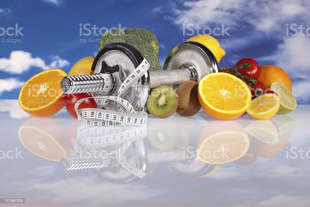 fitness dumbbell and healthy food royalty-free stock photo