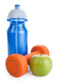 Fitness dumbbell, water bottle and apple