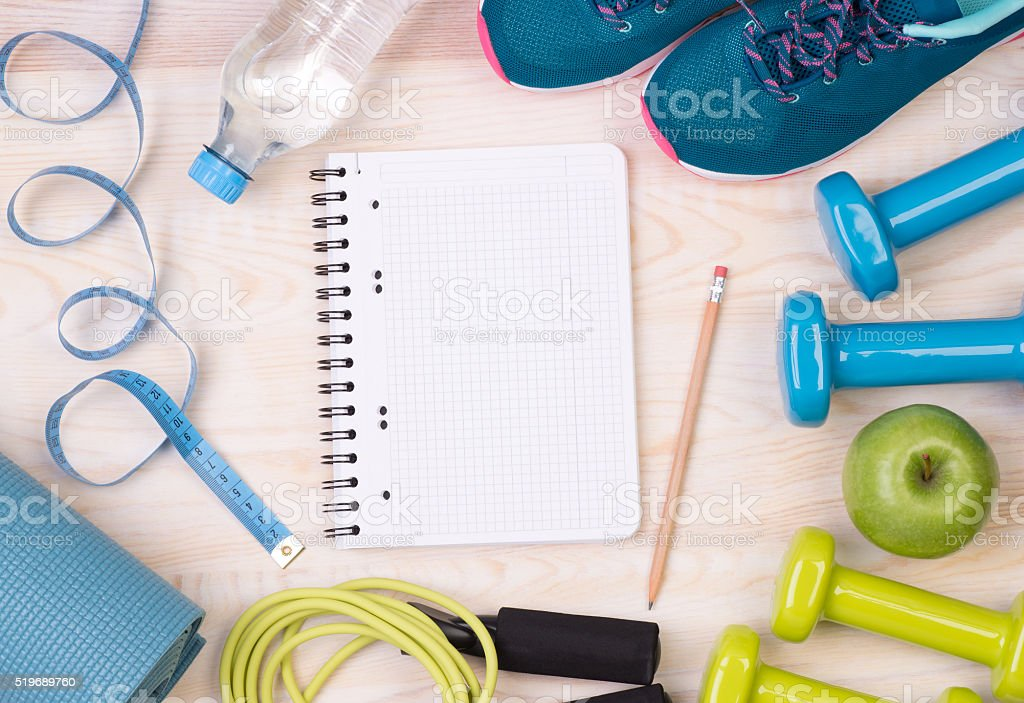 Fitness equipment and blank notebook stock photo