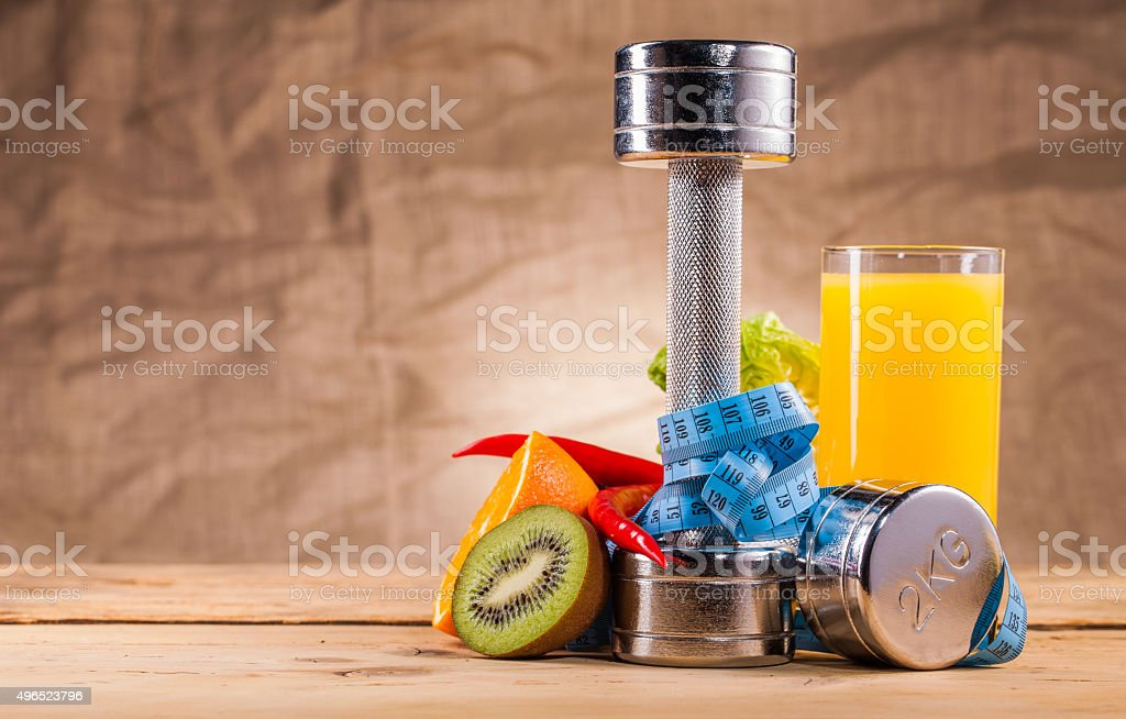 fitness equipment and healthy food stock photo