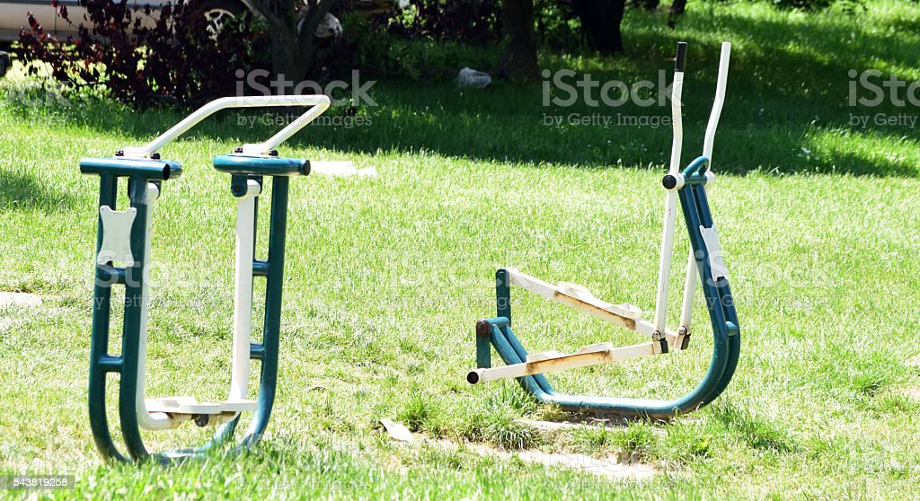 fitness equipment in the park stock photo