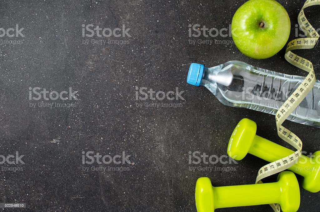 Fitness equipment on dark background stock photo