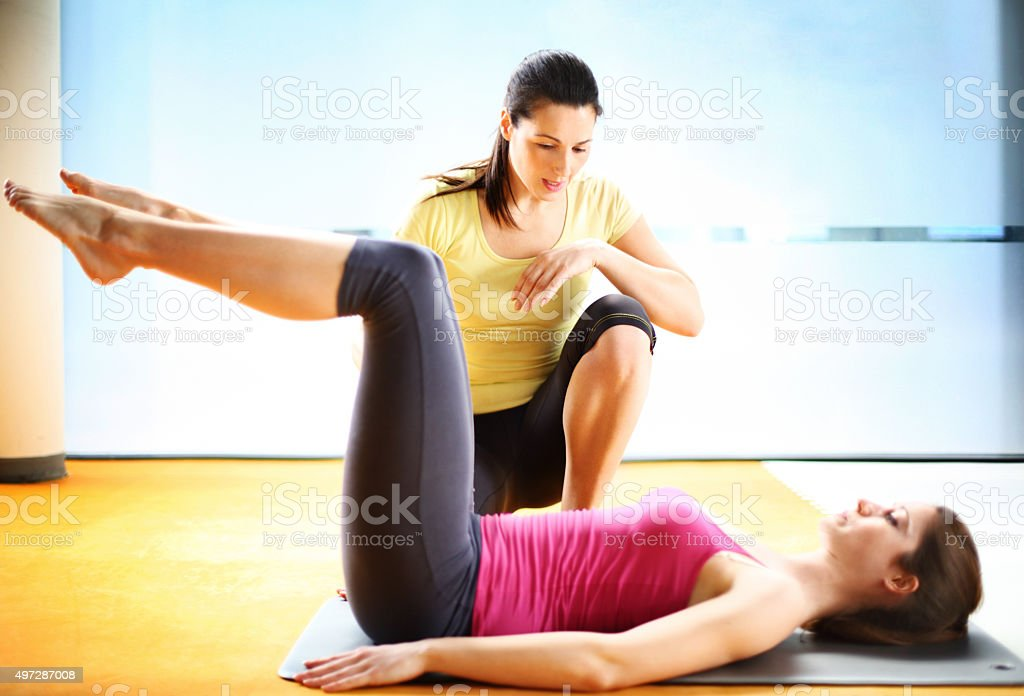 Fitness exercise in a gym. stock photo