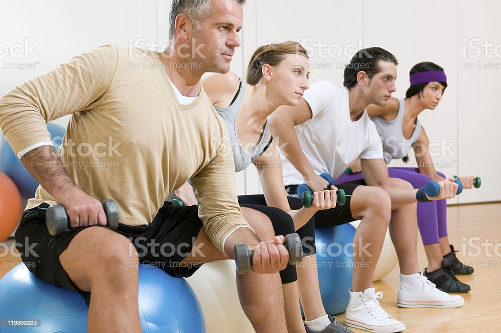 Fitness exercises at gym royalty-free stock photo