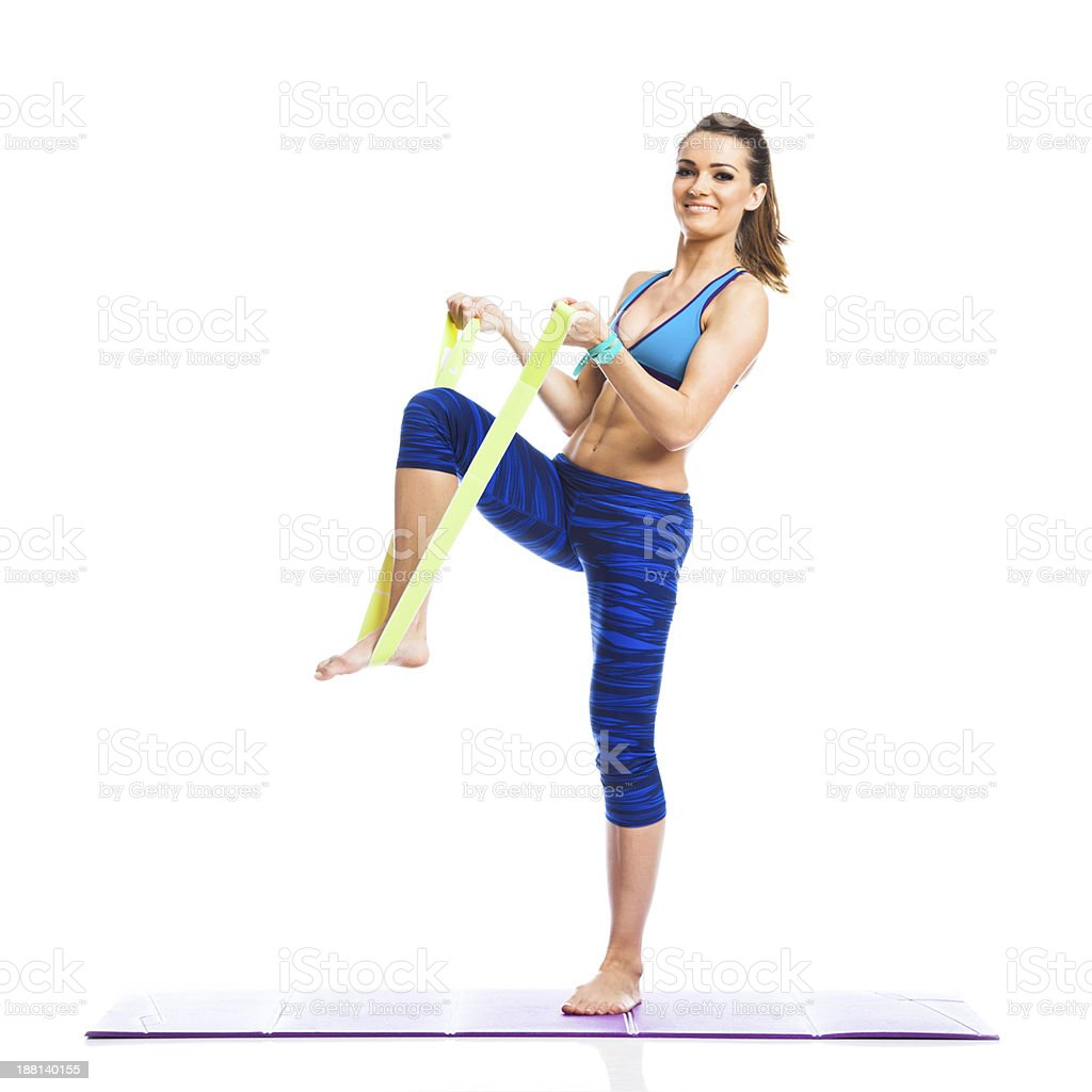 Fitness exercising with resistance band royalty-free stock photo