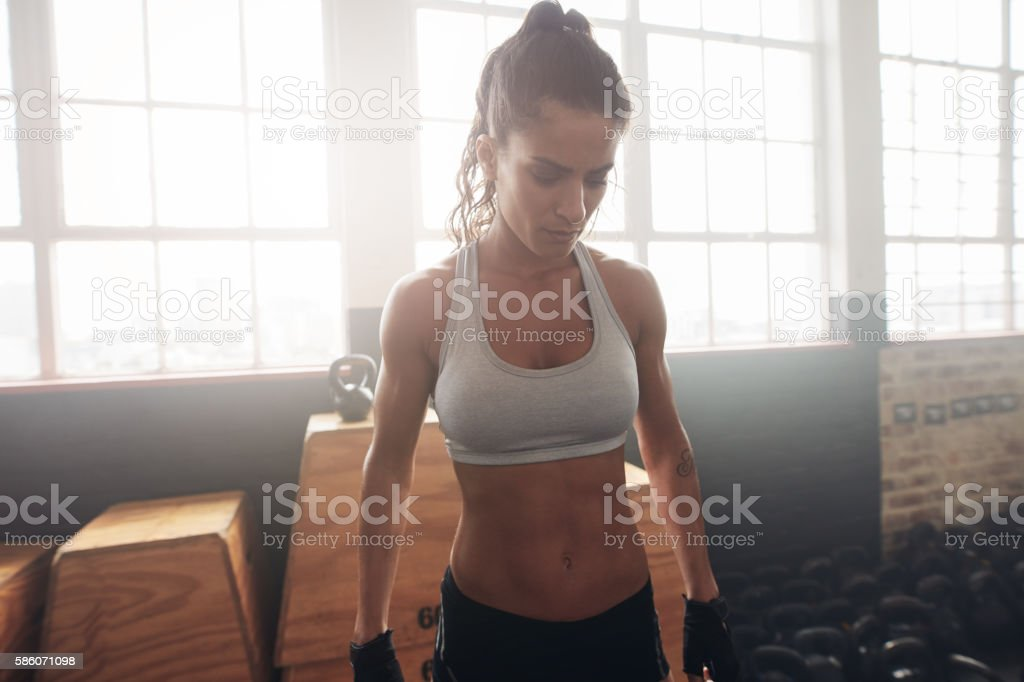 Fitness female standing in the gym stock photo