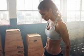 Fitness female taking a break from intense workout