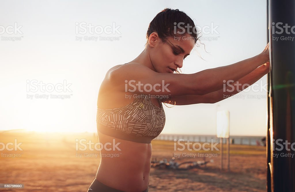 Fitness female taking break from intense workout stock photo