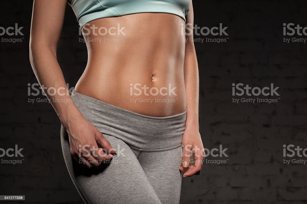 Fitness female woman with muscular body, do her workout, abs stock photo