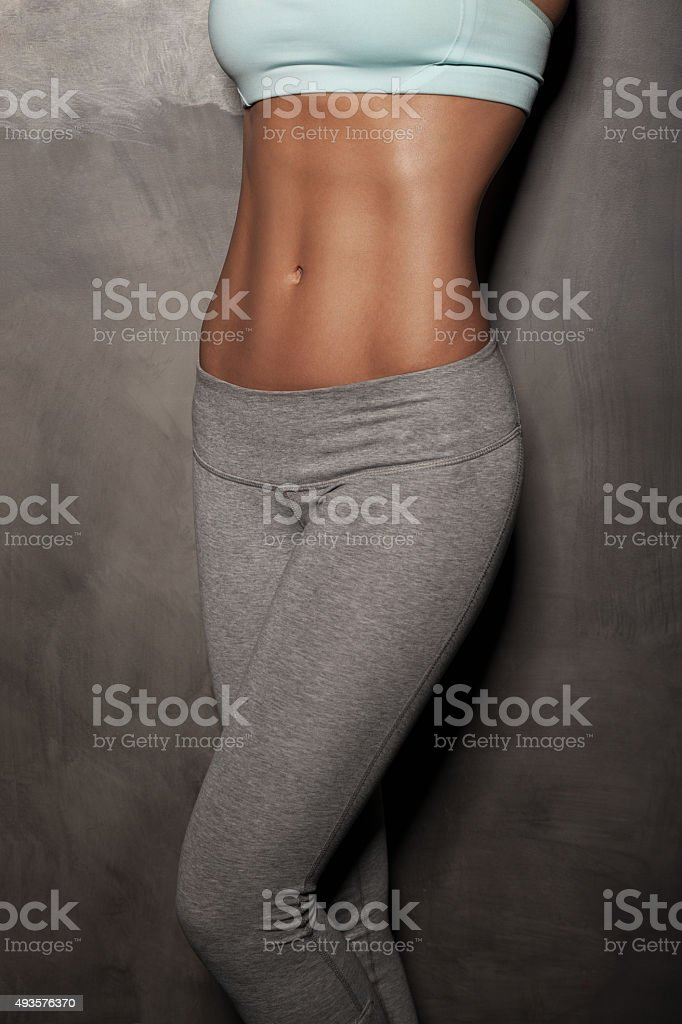 Fitness female woman with muscular body, do her workout stock photo