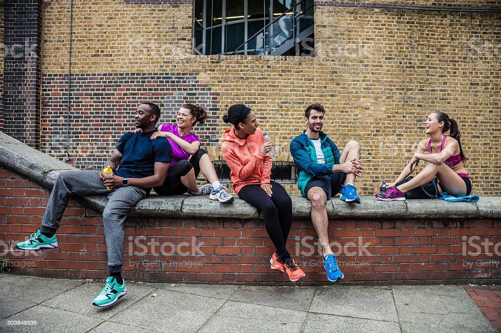 Fitness friends having a break in London Tower Bridge stock photo