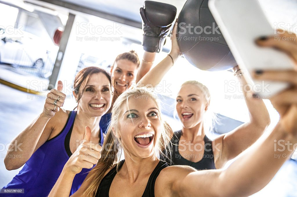 Fitness friends having a break with selfie post workout stock photo