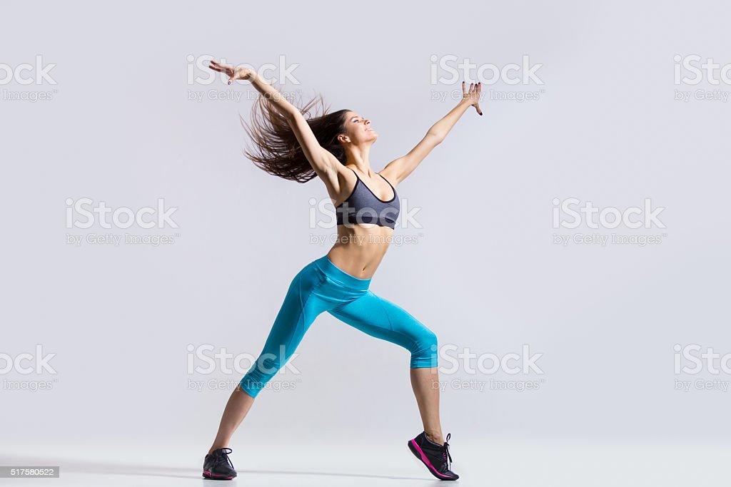 Fitness girl dancing stock photo