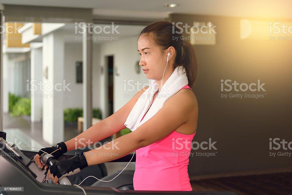 fitness girl exercising on a cardio machine stock photo
