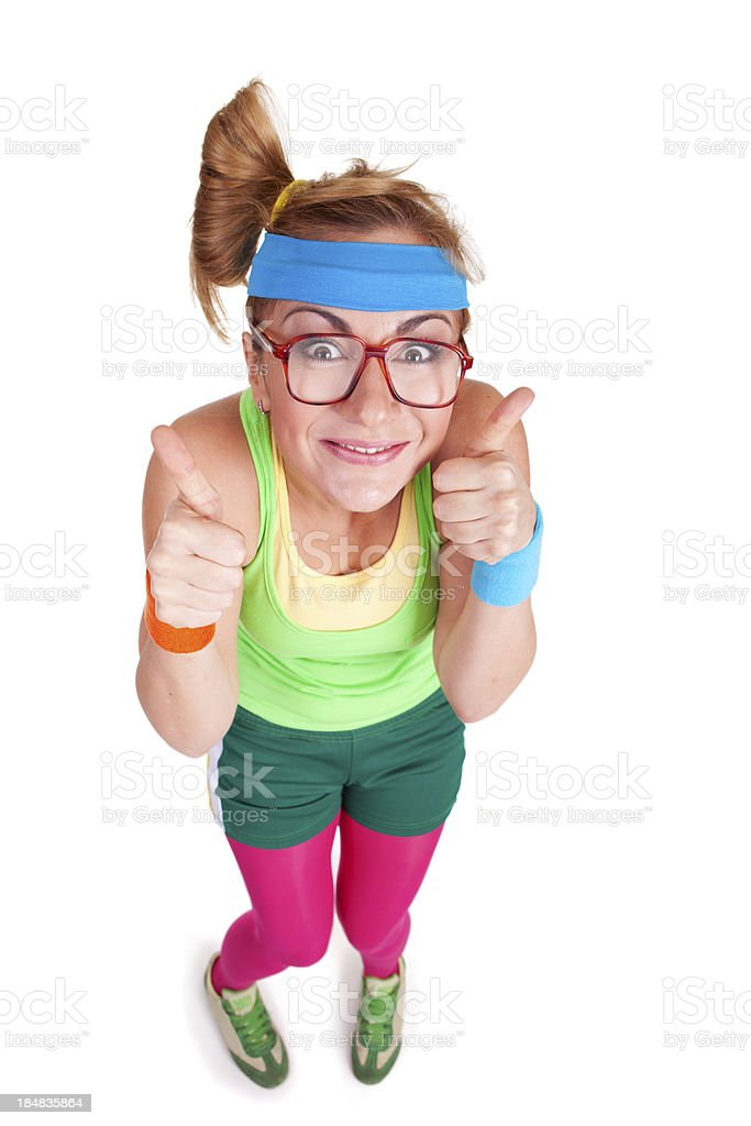 Fitness girl gesturing with thumbs up isolated on white background royalty-free stock photo