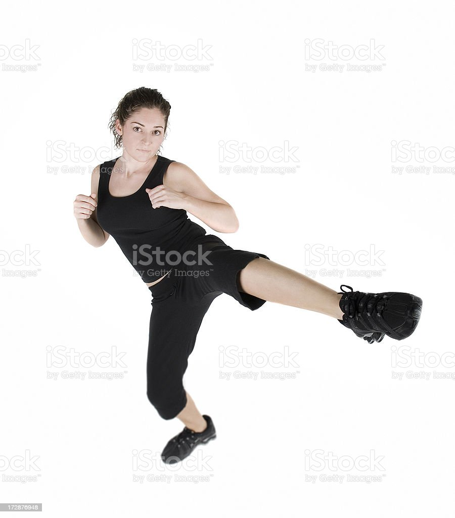 Fitness Girl Kicks at the Camera royalty-free stock photo