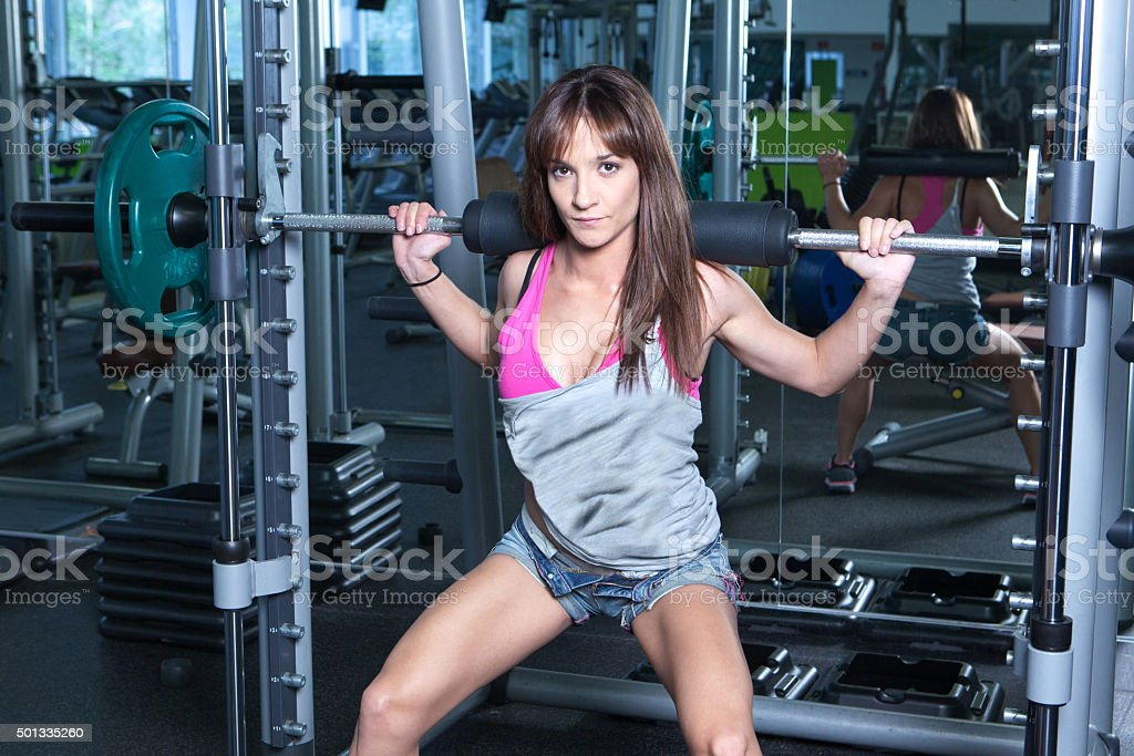 Fitness girl making exercise in a gym stock photo