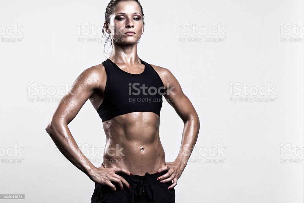 Fitness girl posing after workout stock photo
