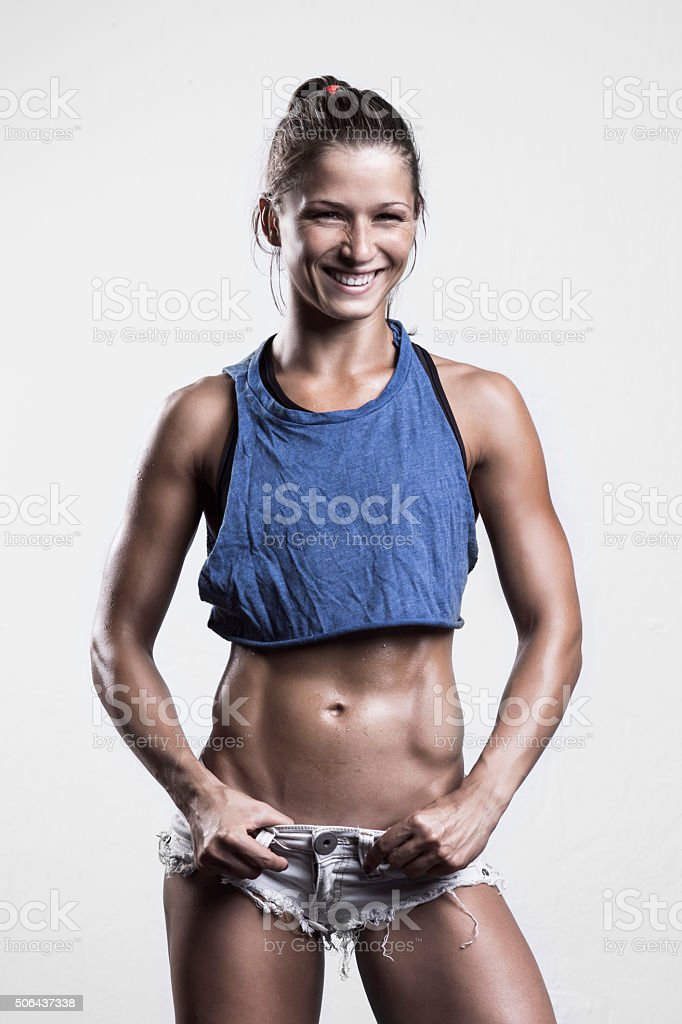 Fitness girl posing and smiling stock photo