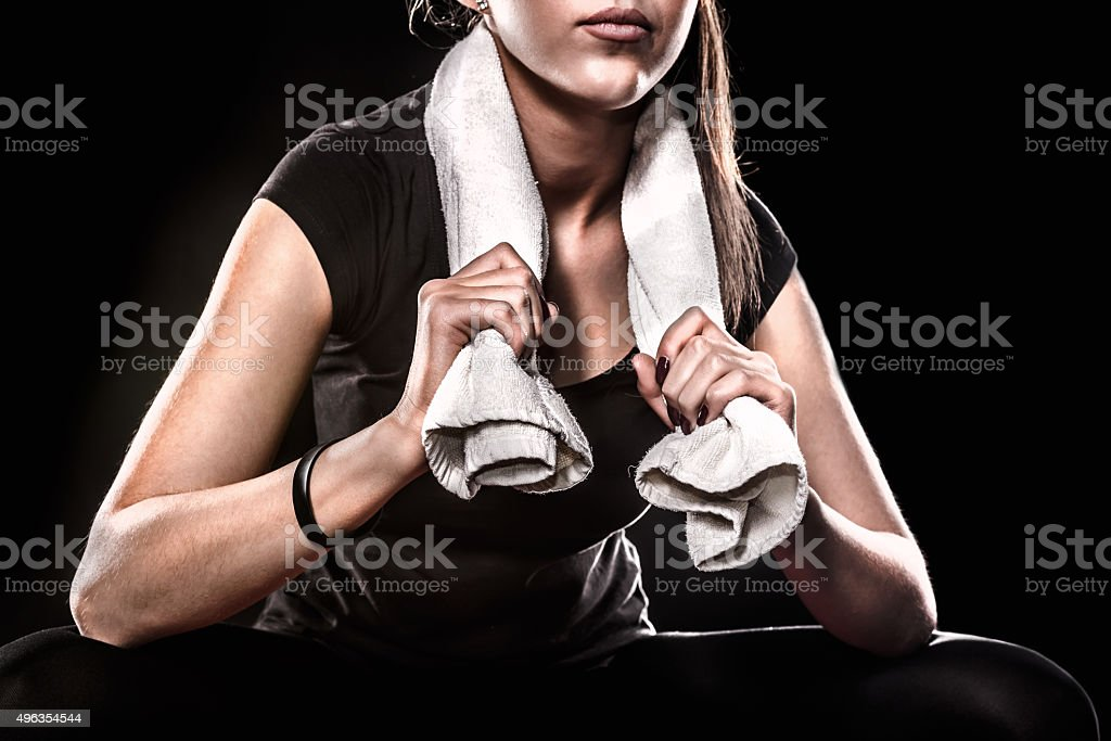 Fitness Girl With Towel On Black Background Detail stock photo