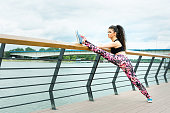 Fitness girls work out by the river