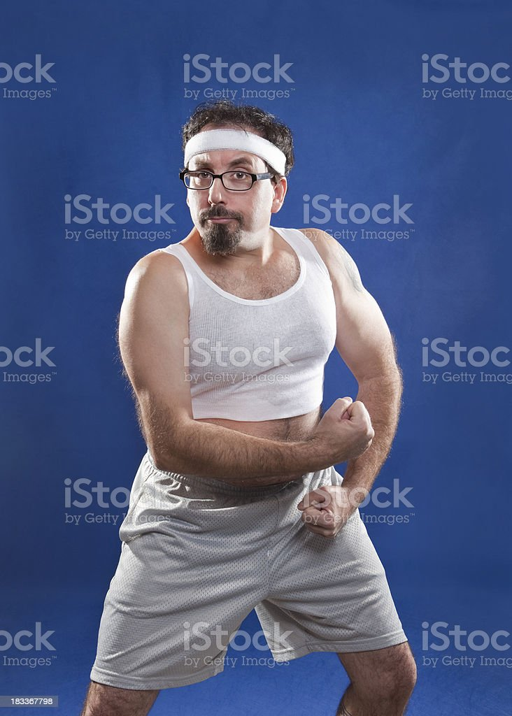 Fitness Guy Flexing Muscles stock photo
