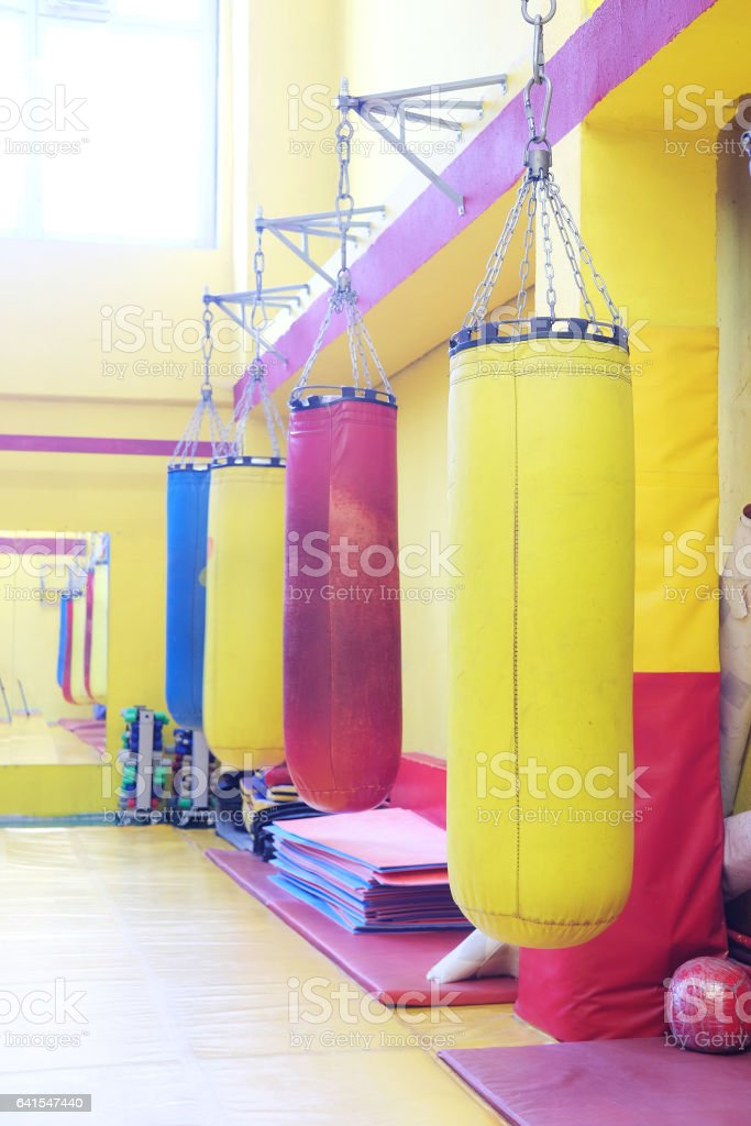 Fitness hall with punching bags stock photo