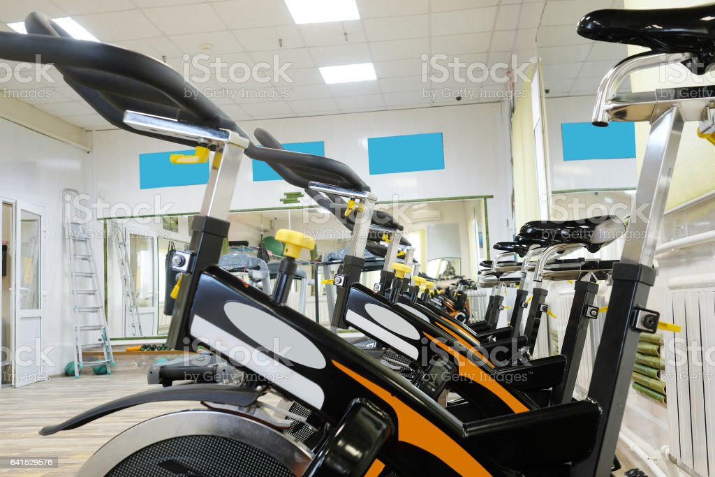Fitness hall with the sport bikes in it stock photo